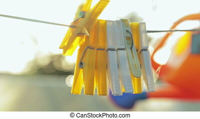 clothes pegs with sun lens flare