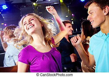 Active teens - Photo of smiling friends dancing during the...