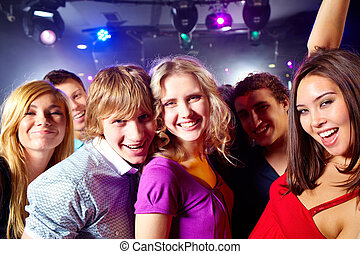 Friends - Portrait of happy glamorous friends in a night...