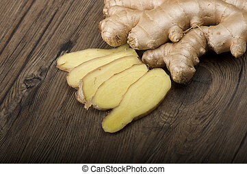 Ginger root sliced on the wooden table