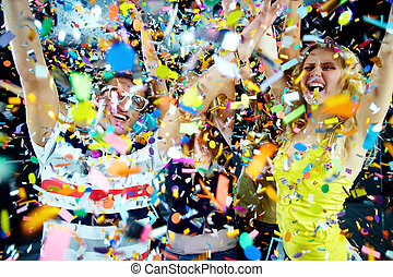 Confetti joy - Photo of excited teenagers in confetti...