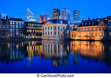 Skyline of The Hague at dusk during blue hour - Skyline of...