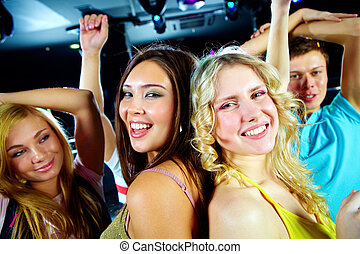 Dynamic girls - Two glamorous girls dancing in night club...
