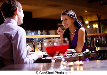 In the restaurant - Photo of couple sitting at the table in...