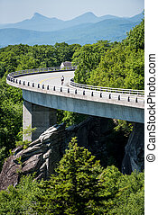 Cyclist on the Linn Cove Viaduct in Summer on a quiet summer...
