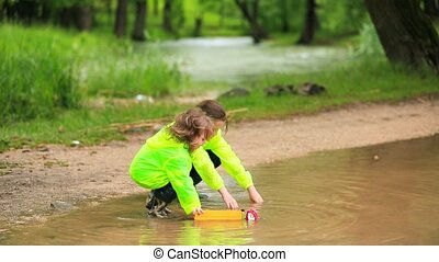 Cute Kids Playing Cars In Huge Puddle In Park - Two...