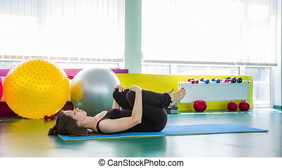 Fit Woman Stretching Legs In Sport Club Hall