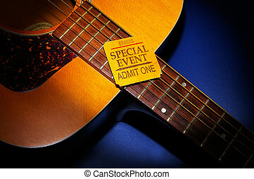 Special-Event ticket stub on an acoustic guitar