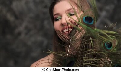 model girl peacock feathers and a beautiful smile
