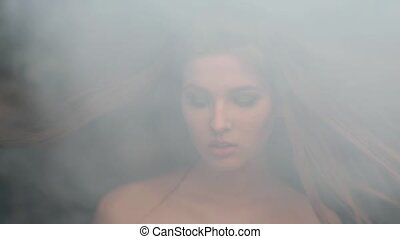 girl model, smoke blowing smoke, tosses up hair biting her...