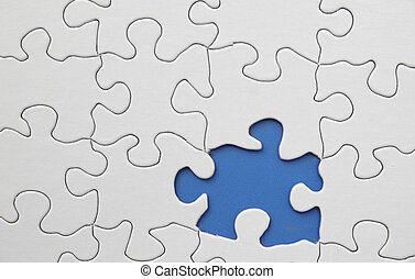 white puzzle with one piece missing, on blue