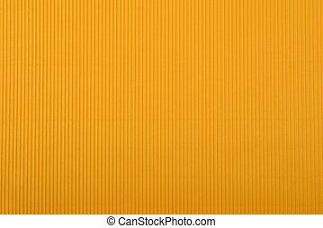 Crinkled cardboard background - Close up of orange crinkled...