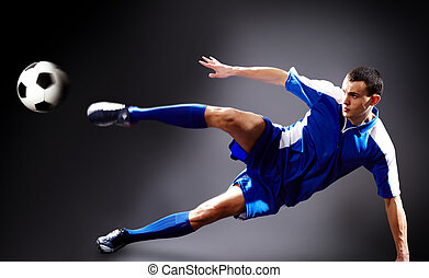 Goal  - Image of soccer player doing flying kick with ball