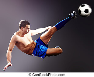 Kick - Professional sportsman kicks soccer ball