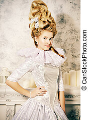 ice queen style - Elegant young woman in a lush white...