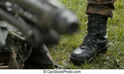 soldier standing at the machine gun
