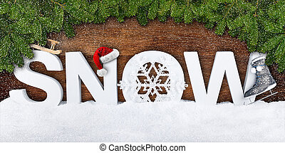 snow lettering with xmas decoration and fir branches on...