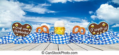 bavarian flag pretzel gingerbread hearts and  beer blue sky