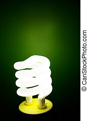 Compact Fluorescent efficient light bulb on green