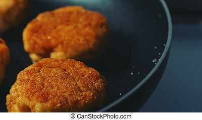 Meat cooking Fresh juicy meat chop cutlet are frying in a...