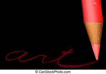 """Closeup of a red colored pencil writing \""""art\"""""""