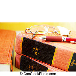 Closeup of law books, glasses and pen