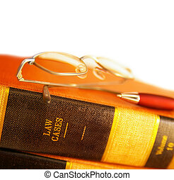 law books with reading glasses and pen, on white