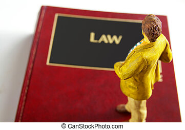 Business man figure standing on a lawbook