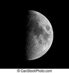 First quarter moon seen with an astronomical telescope seen...