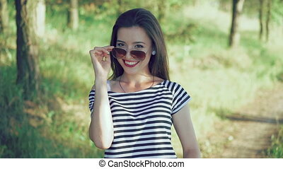 Attractive girl with claret lips posing to camera and...