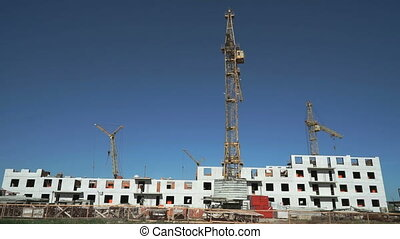 Construction site include four construction cranes - The...
