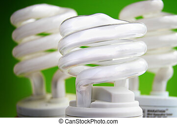 energy efficient light bulbs on green background