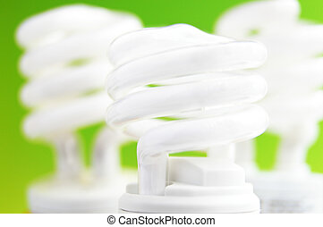 group of compact fluorescent light bulbs on green background