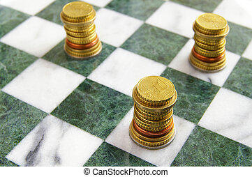 Euro EU coins arranged on a chess board