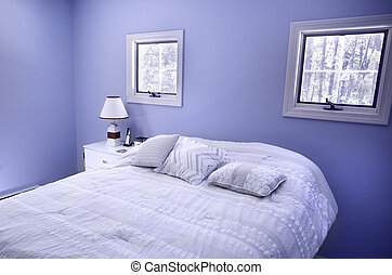 Bedroom with blue walls and windows in Wellfleet, MA on Cape...