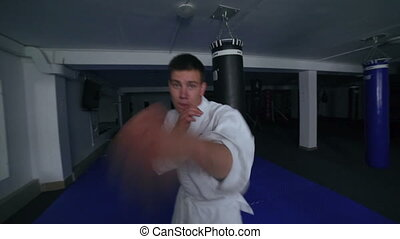 Taekwondo. Movements training by young sportsman on camera...
