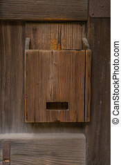 Old wooden mailbox on wood background .
