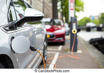 Charging an electric car. - Charging an electric car -...