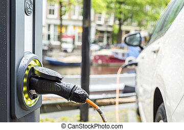 Charging an electric car - Charging an electric car -...