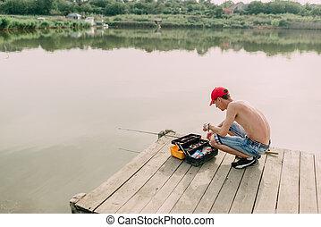fisherman and tackle box