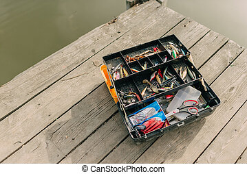 with a fishing tackle box