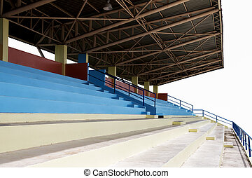Rows of multilevel empty grandstand seats on white...