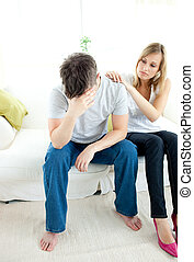 Caucasian couple having an argue in the living-room