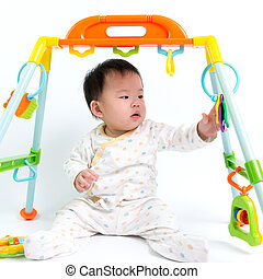 Asian baby playing