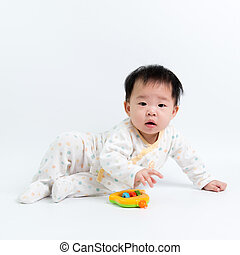 Asian baby with toy