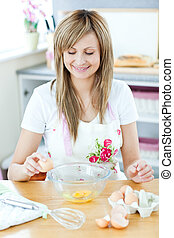 Portrait of a cheerful woman preparing a meal in the kitchen
