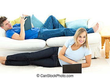 United couple having fun together in the living-room at home