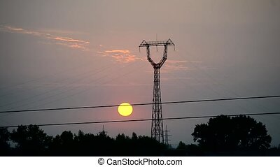 Time lapse of sunrise with transmission tower