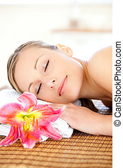 Portrait of a delighted woman having a massage