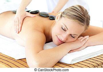 Healthy woman having a massage in a spa